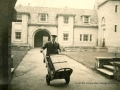 College porter with luggage c.1935